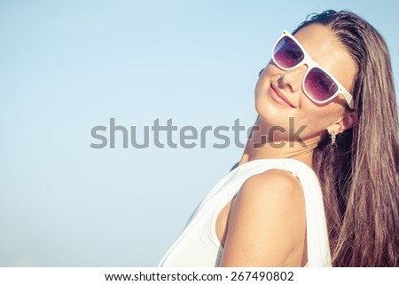 Fashion Lifestyle, Beautiful brunette girl in the sunglasses  on the beach at the day time. Travel and Vacation. - stock photo