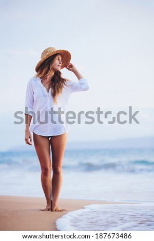 Fashion Lifestyle, Beautiful girl on the beach at sunset. - stock photo