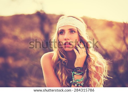 Fashion Lifestyle, Portrait of Beautiful Young Woman Backlit at Sunset Outdoors. Soft warm sunny colors. - stock photo