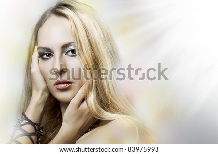 Fashion light portrait of young adult beauty woman face closeup. Sexy blond model on blur background