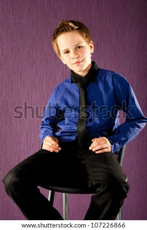 fashion little boy in a studio - stock photo