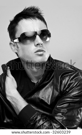 fashion male brunette portrait wearing black jacket and sunglasses - stock photo