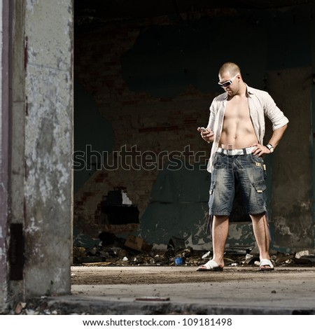 Fashion Male Model Standing In Old Ruined Industrial Building