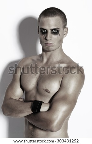 Fashion male with black eyeshadow - stock photo