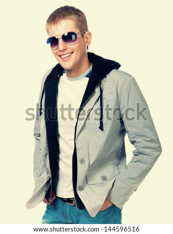 fashion man in sunglasses on light background
