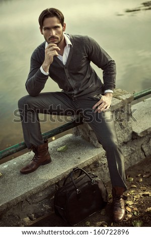 Fashion man posing - stock photo