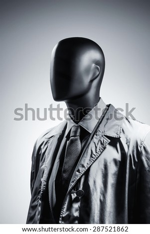 Fashion mannequin in suit over dark grey background. Black White photo - stock photo