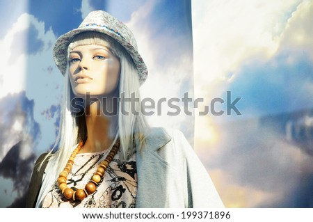 Fashion mannequin presenting summer collection in window shop  - stock photo