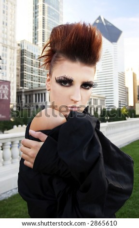 Fashion model, downtown of Chicago in the background - stock photo