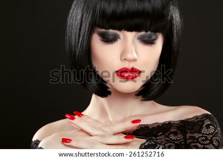 Fashion model girl face, beauty woman makeup and red manicure. Bob black hairstyle. Brunette woman posing over black background. - stock photo