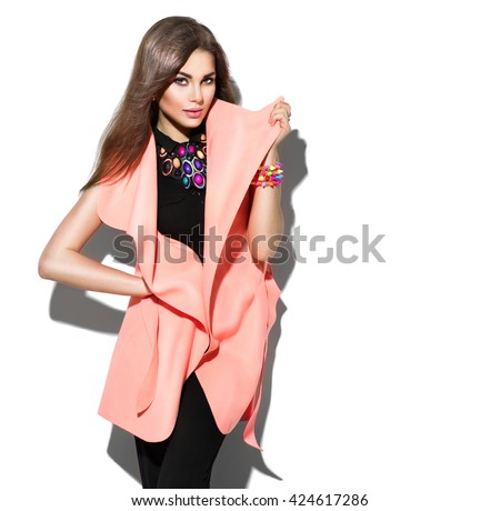 Fashion Model girl isolated over white background. Beauty stylish brunette woman posing in fashionable clothes in studio. Casual style with beauty accessories. High fashion urban style - stock photo