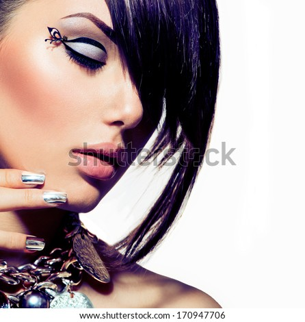 Fashion Model Girl Portrait. Trendy Hair Style. Short Haircut. Hairstyle. Beauty Woman closeup. Fringe. Hairdressing. Silver Metallic Accessories and Manicure. Beauty Woman close up. Perfect Skin - stock photo