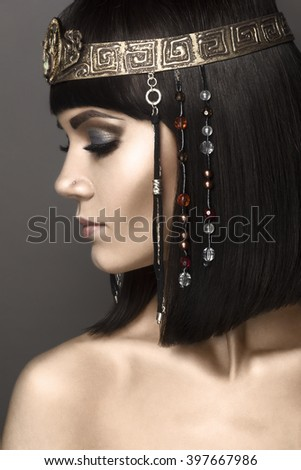 Fashion Model Girl Portrait with bright Makeup. Creative Hairstyle. Hairdo. Make up.  Cleopatra. Profile - stock photo