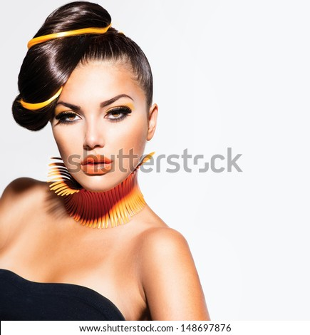 Fashion Model Girl Portrait with Yellow and Orange Makeup. Creative Hairstyle. Hairdo. Make up. Beauty Woman isolated on a White Background - stock photo
