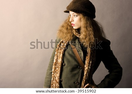 fashion model in autumn/winter clothes. High contrast photo - stock photo
