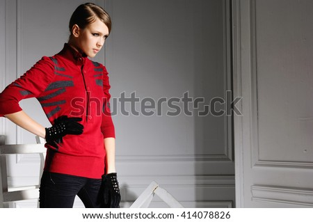 fashion model in fashion dress with gloves posing in the studio