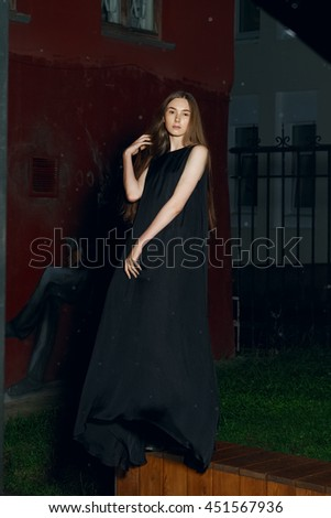 fashion model in long designers dress in night show