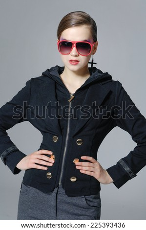 fashion model in sunglasses posing  - stock photo