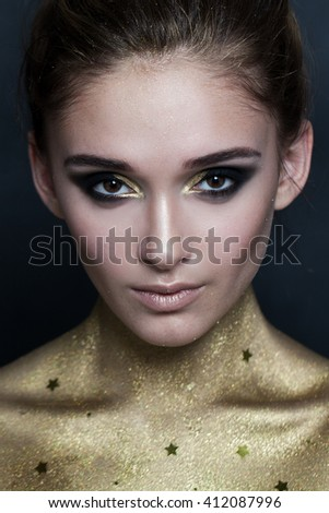 Fashion Model. Makeup and Golden Skin - stock photo