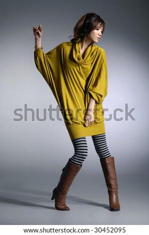 fashion model Posed on light background - stock photo