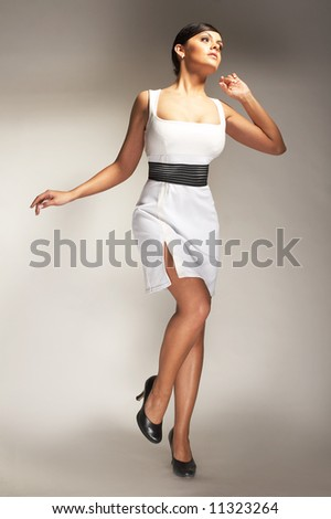 Fashion model Posed on light background in white dress - stock photo