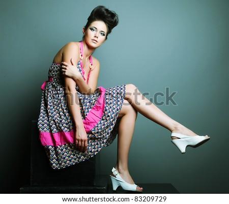Fashion model. Posing in studio - stock photo