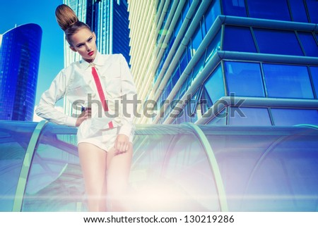 Fashion model posing over big city background.