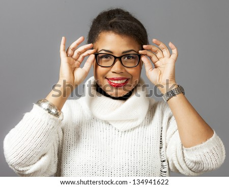 Fashion model posing with glasses and white shirt on grey background. - stock photo