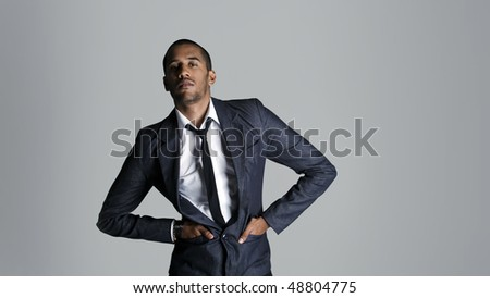 Fashion model stands ready to take on the world - stock photo