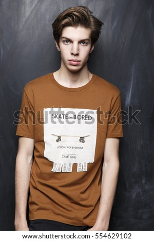 Fashion model tests. A young man is in the studio