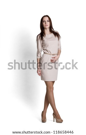 Fashion model wearing beige dress with emotions - stock photo