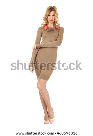Fashion model wearing golden sweater dress