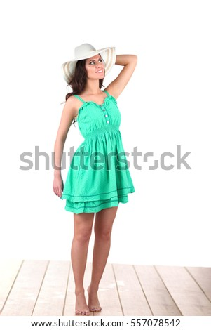 Fashion model wearing green dress, isolated on white background