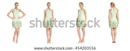 Fashion model wearing green dress with emotions on white background