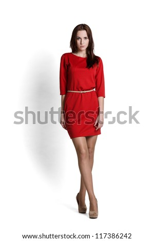 Fashion model wearing red dress with emotions - stock photo