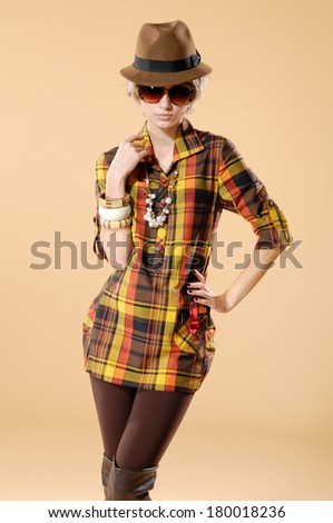fashion model wearing sunglasses- beige background - stock photo