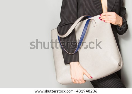 Fashion model with bag. posing in the studio - stock photo