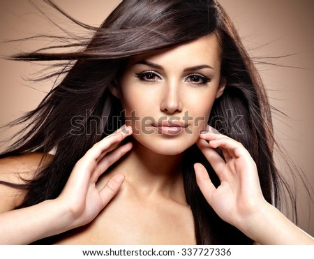 Fashion model  with beauty long straight hair.  Creative studio image. - stock photo