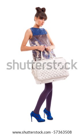 Fashion model with big bag. Isolated on white background