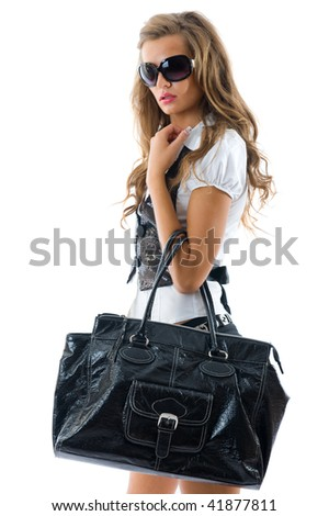 Fashion model with big bag. Isolated over white background