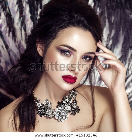 Fashion model with jewelry, modern natural make up. Black and white background.