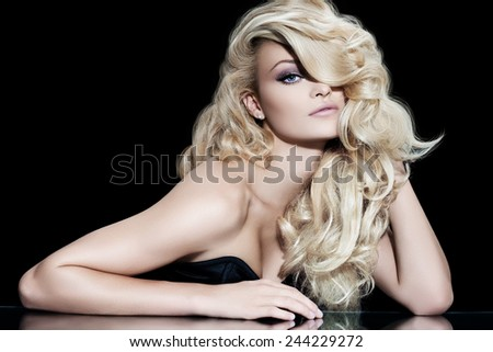 Fashion model with long blond hair. - stock photo