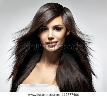 Fashion model with long straight hair. Fashion model posing at studio.