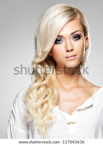 Fashion model with long white hair  and bright make-up. Portrait of glamour woman posing at studio - stock photo