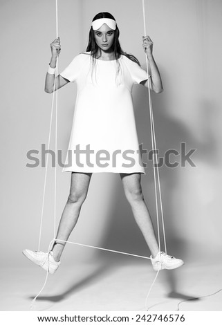 Fashion model woman in black on gray background - stock photo