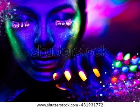 Fashion model woman in neon light, portrait of beautiful model girl with fluorescent make-up, Art design of female disco dancer posing in UV, colorful make up. Isolated on black background - stock photo