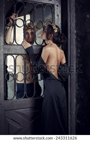 Fashion models couple king and queen in abandoned interiorrs - stock photo