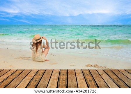 Fashion  of asian beautiful girl  with hippie outfit and hat outdoors at sunset on the sea. Soft warm color tone. Boho lifestyle. Bohemian Style. - stock photo