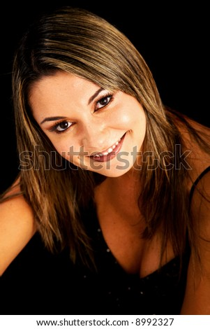 fashion or casual woman portrait giving a big smile - isolated over a black background