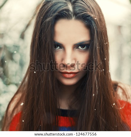 Fashion outdoor portrait of young serious woman. - stock photo